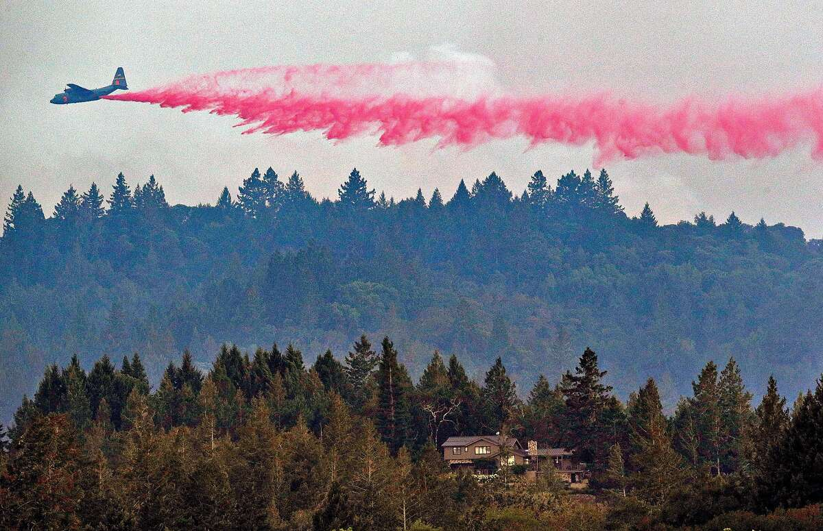 Fire air support planes drop fire retardant on the Walbridge Fire in the mountain range west of Healdsburg, Calif., on Thursday, August 20, 2020.