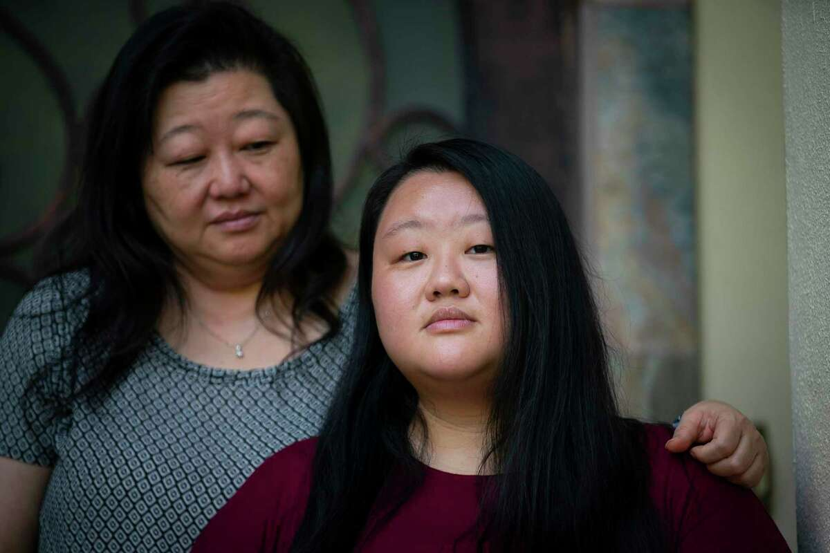 Ashlee Phan, photographed with her mother, Margaret Lynn, was working her job as a surgical nurse when she began running a fever. At only 25, she did not think it was COVID-19. Days later, her mom found her unconscious and near death. Ashlee, who is now negative, spent time in the ICU and has since been recovering at her mother's home. Photographed on Thursday, Aug. 13, 2020, in Houston.