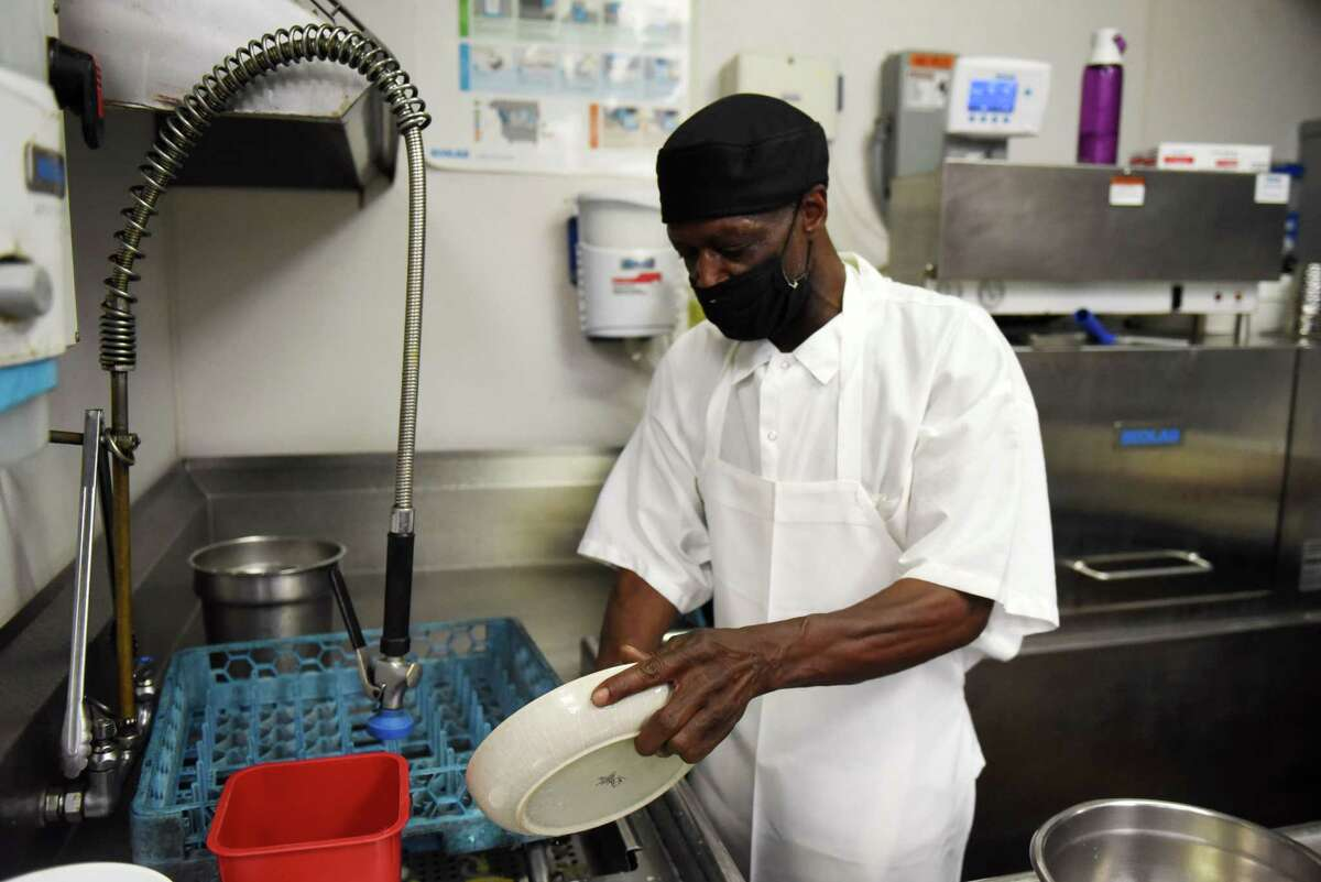 Jerry Russell, a decades-long dishwasher currently working at Yono's, works at his station on Friday, Aug. 21, 2020, at Yono?•s/dp: An American Brasserie in Albany, N.Y. (Will Waldron/Times Union)