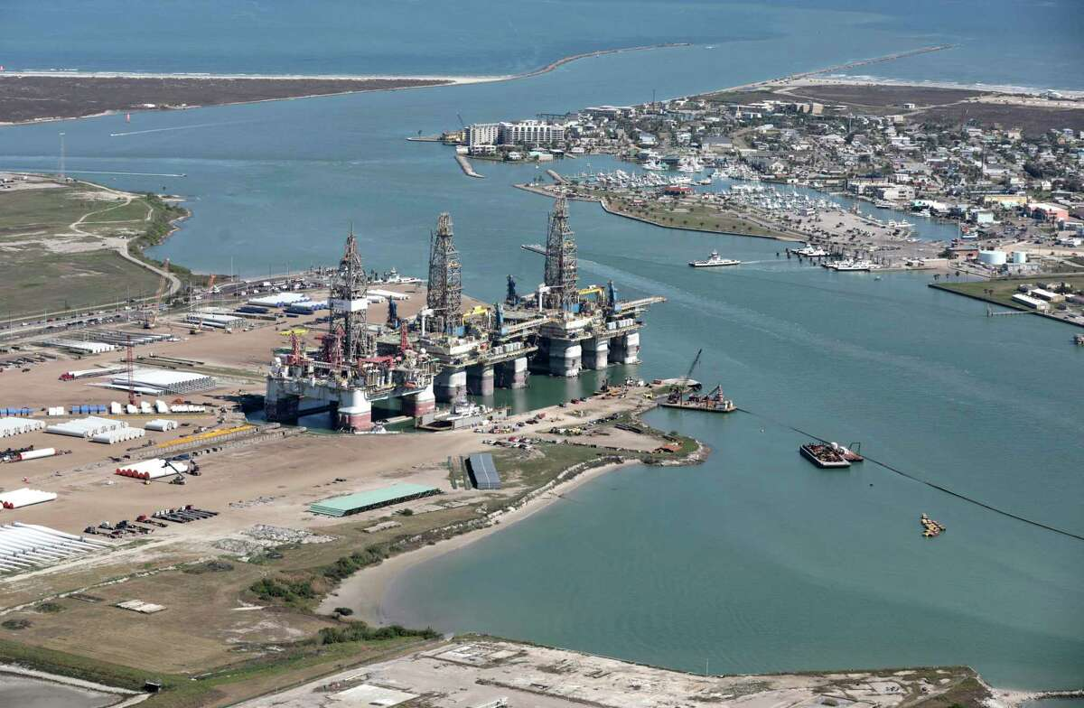 Industrial operations on Harbor Island with the popular town of Port Aransas to the right. A proposal to build a terminal for giant crude haulers right across from the Port Aransas Marina and city park is drawing pushback from locals. Tuesday, Feb. 25, 2020.