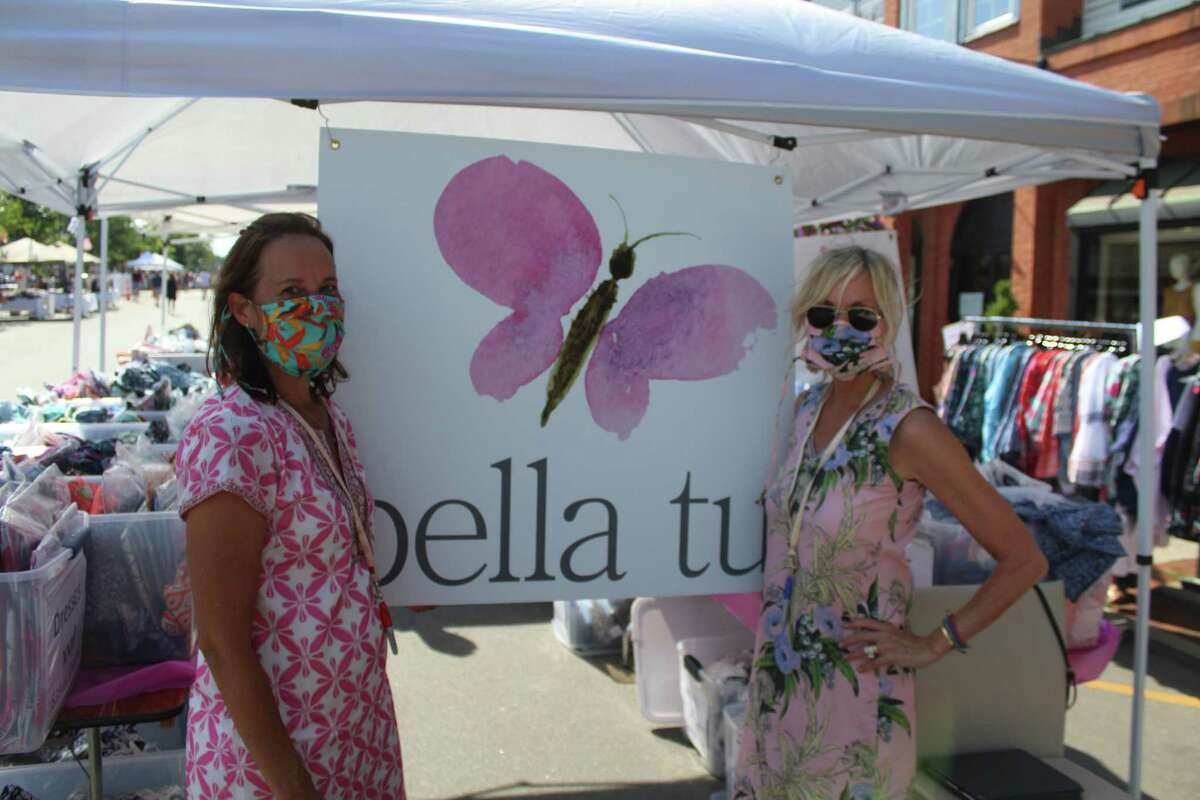 Rachael Rainieri and Jeanne Daniel of Bella Tu moved sales outside onto Elm Street on Friday.