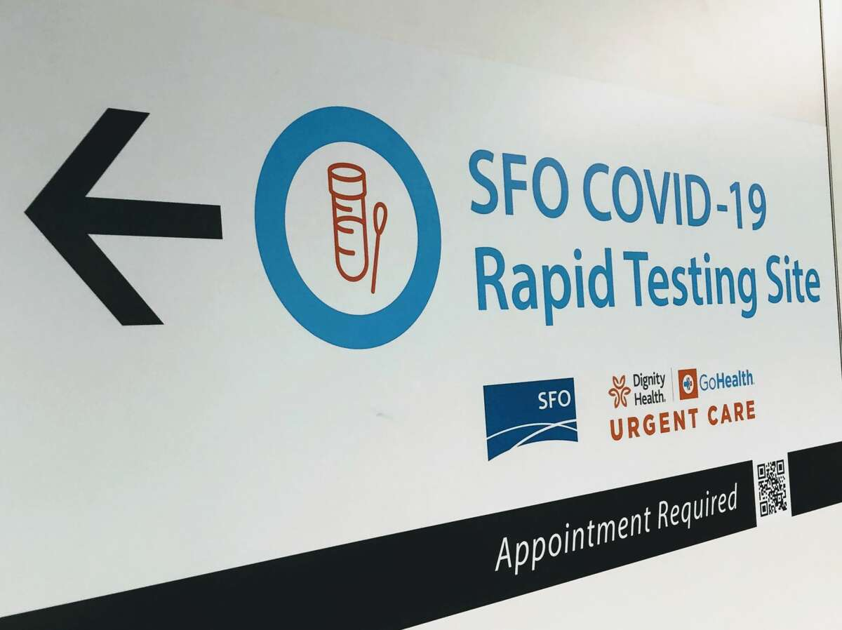 A sign directs airline and airport employees to SFO's new coronavirus rapid testing site in the International Terminal.