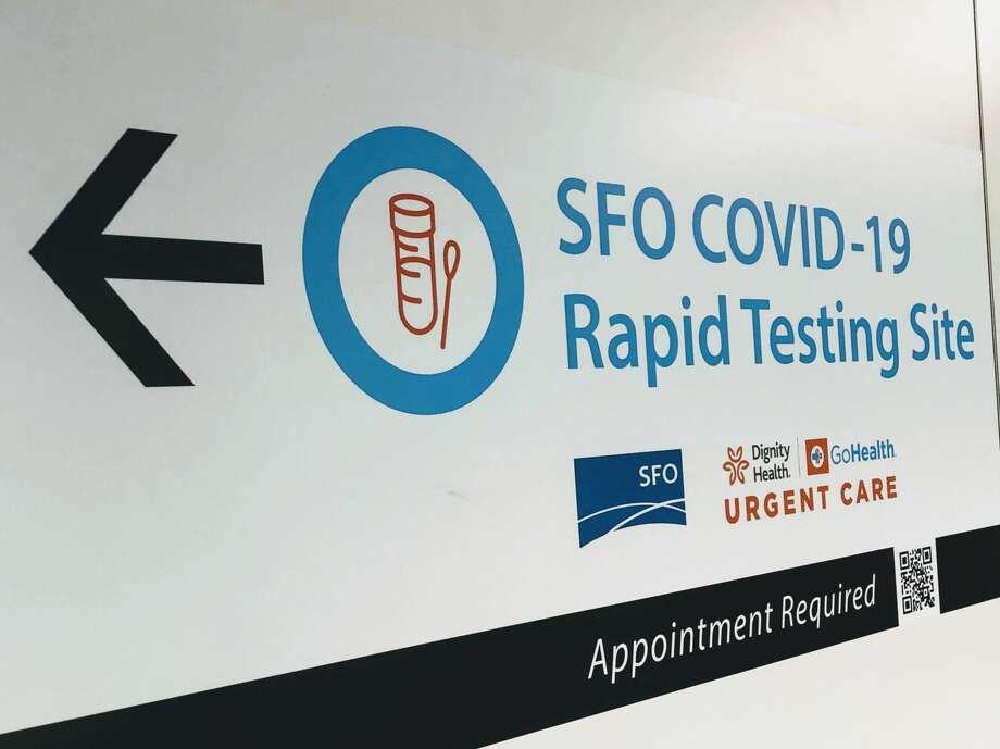 A sign directs airline and airport employees to SFO's new coronavirus rapid testing site in the International Terminal. Photo: SFO