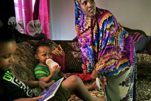 Muhamed fled Somalia two years ago. Now, she's a single mom to her son Abdullahi, 6, and daughter Rahma, 2. She recently quit working at the Tyson plant after she tested positive for coronavirus.
