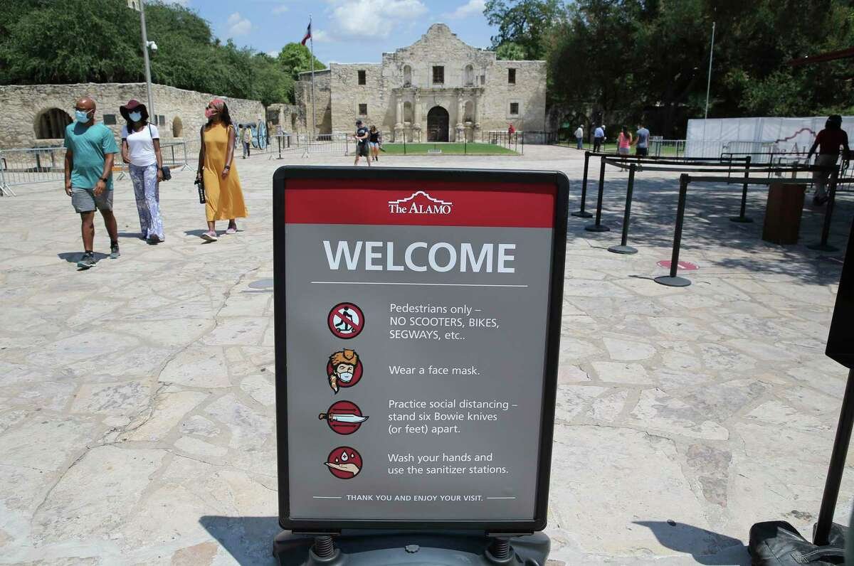 Visitors stroll through the grounds at the Alamo on Friday, Aug. 21, 2020. The grounds reopened Thursday to allow visitors in limited capacity to tour around the monument. They are open 9 a.m.-5:30 p.m. The only building open is the gift shop, 10 a.m.-5:30 p.m.