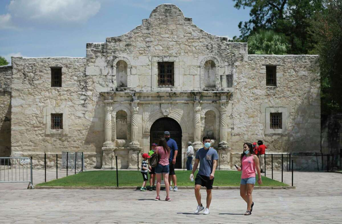 Visitors stroll the grounds at the Alamo on Friday, Aug. 21, 2020. The grounds reopened Thursday to allow visitors in limited capacity to tour around the monument. They are open 9 a.m.-5:30 p.m. The only building open is the gift shop, 10 a.m.-5:30 p.m.