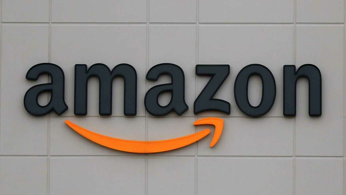 FILE - This April 1, 2020 file photo shows the Amazon DTW1 fulfillment center in Romulus, Mich., April 1, 2020. Amazon says executive Wilke, who oversees the companya€™s retail business, will retire early in 2021. He will be replaced by Dave Clark, who runs Amazon's warehouses and delivery network. Wilke has been at Amazon for more than two decades. (AP Photo/Paul Sancya)