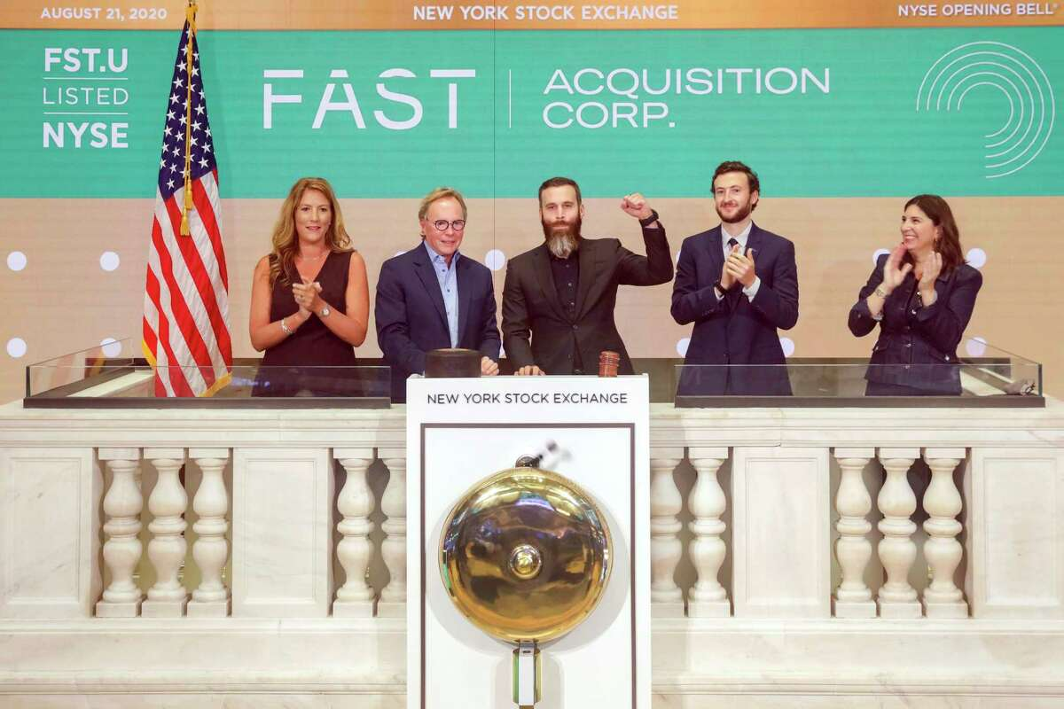 In this photo taken from video provided by the New York Stock Exchange, Fast Acquisition Corp. co-CEOs Sandy Beall, second left, and Doug Jacob, third left, are joined by NYSE President Stacey Cunningham Corp., right, during the New York Stock Exchange opening bell ceremonies celebrating the company's IPO, Friday, Aug. 21, 2020. (Courtney Crow/New York Stock Exchange via AP)