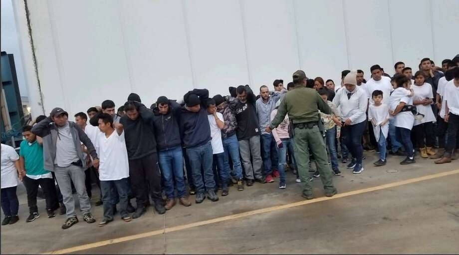 U.S. Border Patrol agents said they discovered these 83 people inside a trailer. Authorities said the individuals were immigrants who had crossed the border illegally. The truck driver was convicted on Thursday on human smuggling charges Photo: Courtesy Photo /U.S. Attorney's Office