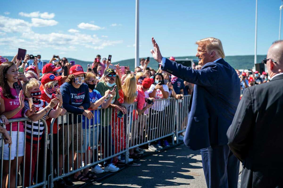 President Donald Trump greets supporters on Thursday at Wilkes-Barre Scranton International Airport in Avoca, Pa. The Republican National Convention next week will kick off with an in-person roll call on Monday in Charlotte, N.C. (Doug Mills/The New York Times)