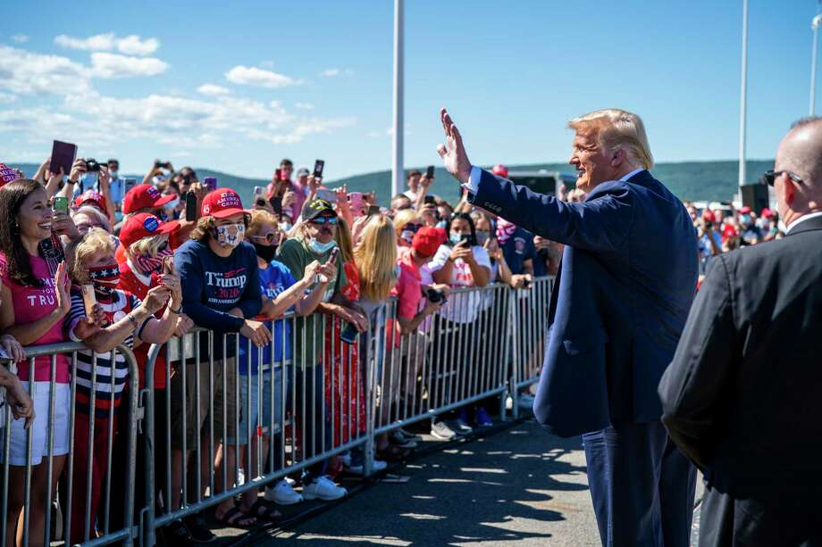 President Donald Trump greets supporters on Thursday at Wilkes-Barre Scranton International Airport in Avoca, Pa. The Republican National Convention next week will kick off with an in-person roll call on Monday in Charlotte, N.C. (Doug Mills/The New York Times) Photo: DOUG MILLS, STF / NYT / NYTNS