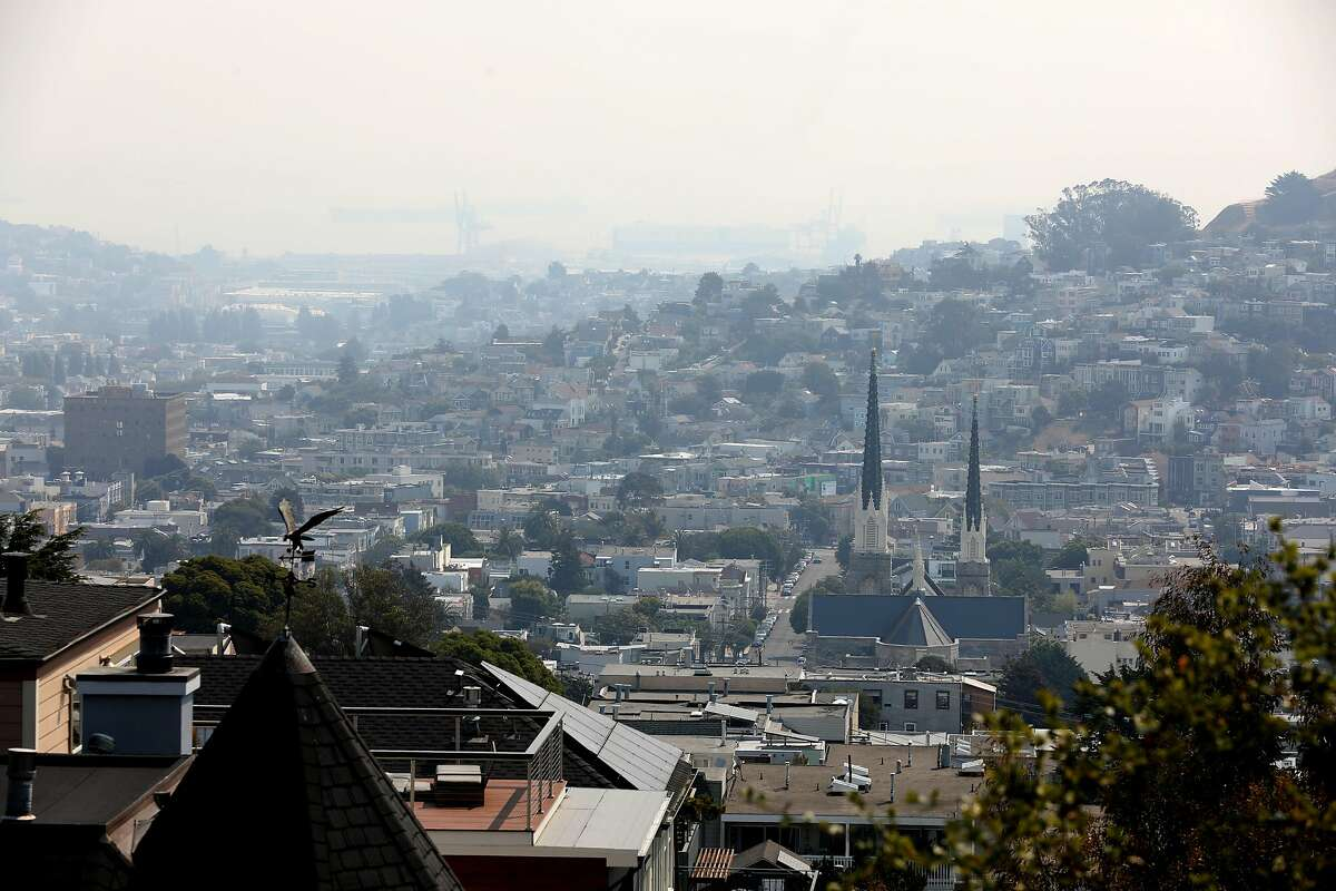 Wildfire smoke covers the skies seen looking toward Noe Valley from Valley at 29th streets on Aug. 19, 2020, in San Francisco.