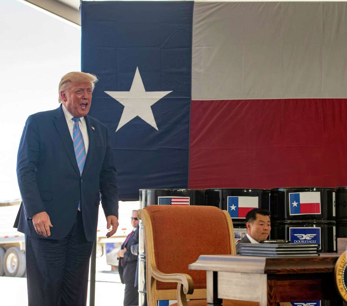 President Donald Trump talks to a crowd at a Double Eagle Energy oil and gas operation in front of Latshaw Rig No. 43 on Wednesday, July 29, 2020 in Midland County. Jacy Lewis/Reporter-Telegram
