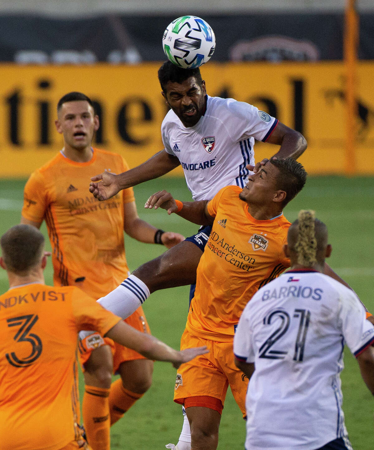 FC Dallas midfielder Thiago Santos (5) wins a header over Houston Dynamo midfielder Darwin Ceren (24) during the first half of the MLS match Friday, Aug. 21, 2020, at BBVA Stadium in Houston. Friday's match was the first Dynamo home game since Feb. 29.