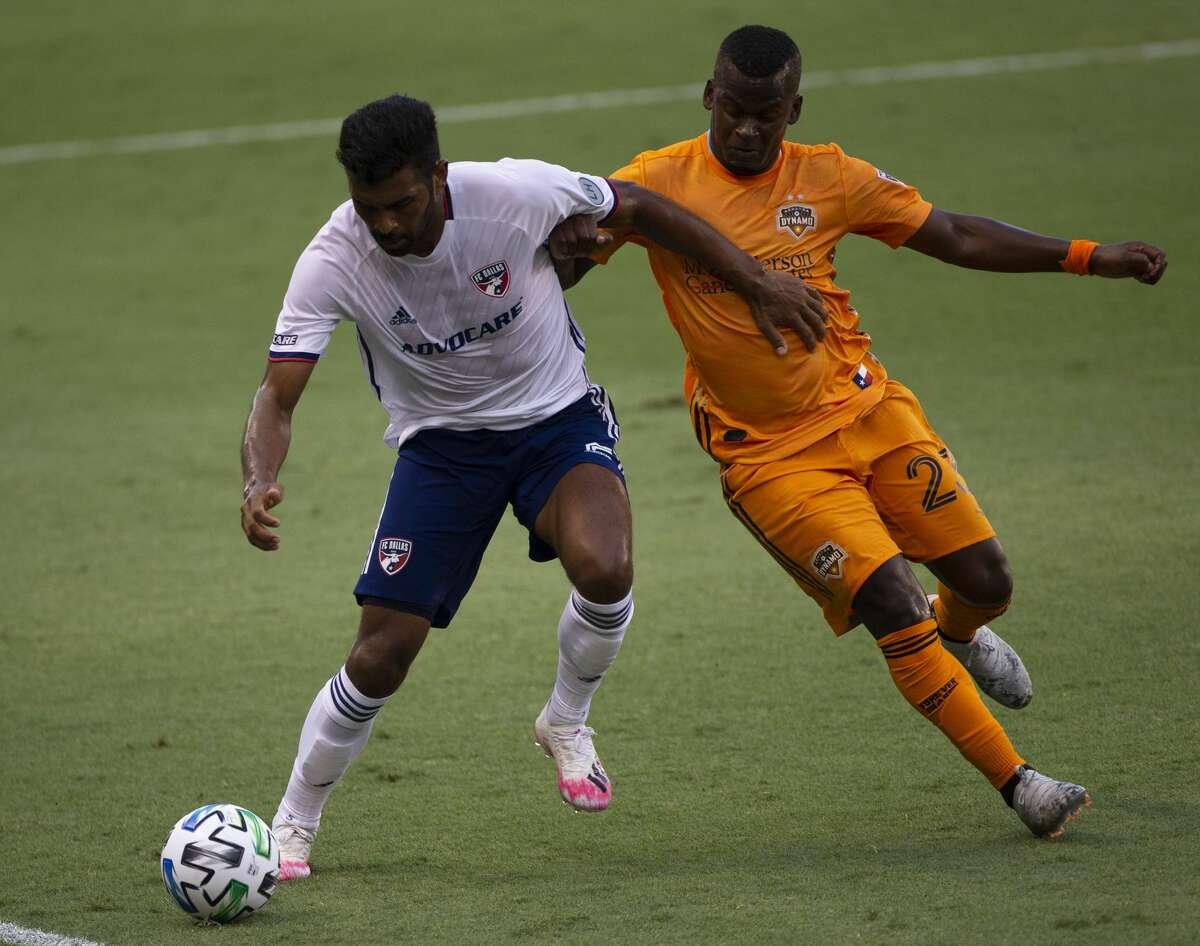 Houston Dynamo forward Darwin Quintero (23) battles FC Dallas midfielder Thiago Santos (5) during the first half of the MLS match Friday, Aug. 21, 2020, at BBVA Stadium in Houston. Friday's match was the first Dynamo home game since Feb. 29.