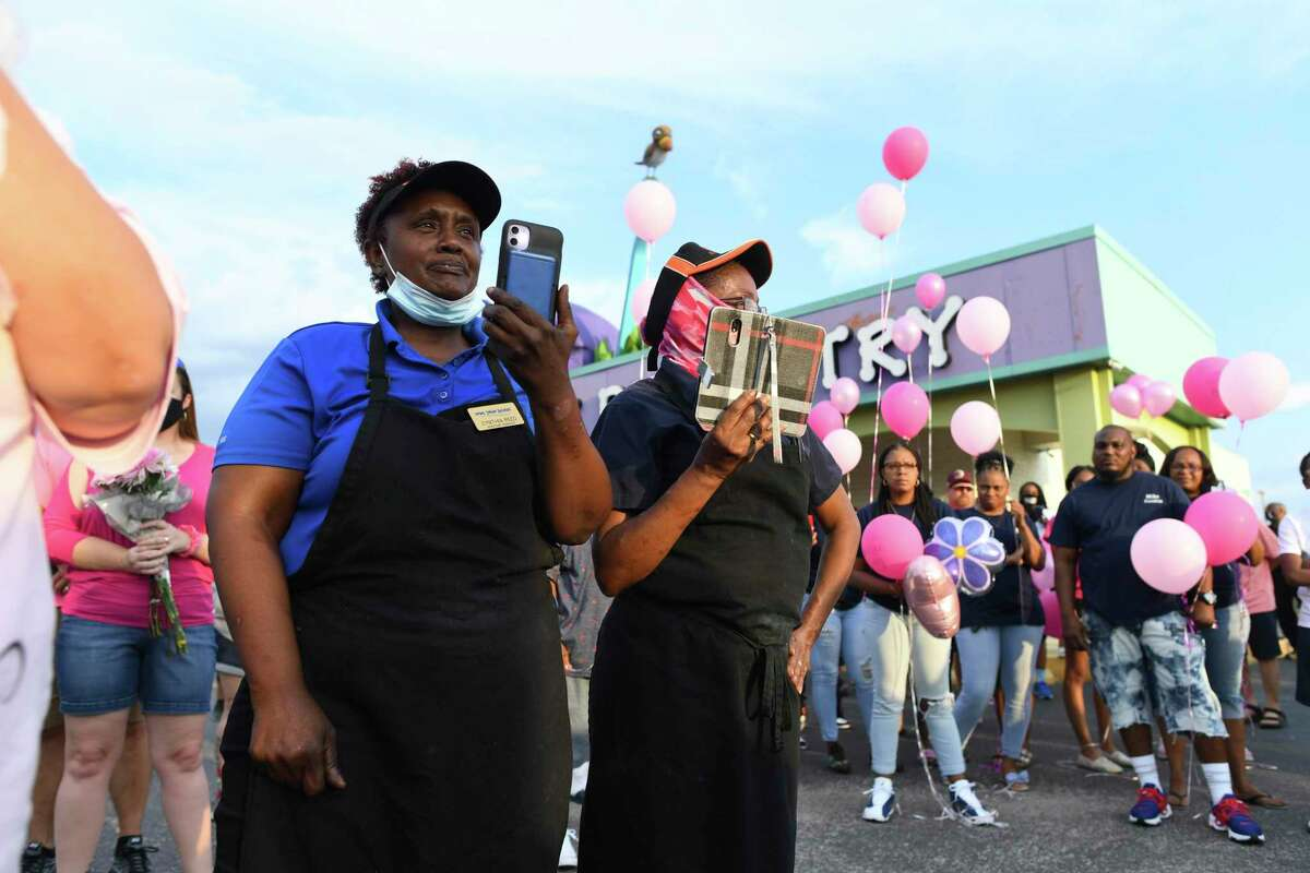 Cynthia Reed, manager of the Long John Silver's restaurant in the 5500 block of Walzem, watches during a vigil for 11-year-old Donita Elizabeth Henry-Phillips, who died from gunshot wounds suffered on Saturday, during a vigil on Friday, Aug. 21, 2020. Reed was one of several employees of the restaurant who assisted and comforted the child. A second victim is hospitalized. No arrests have been made.
