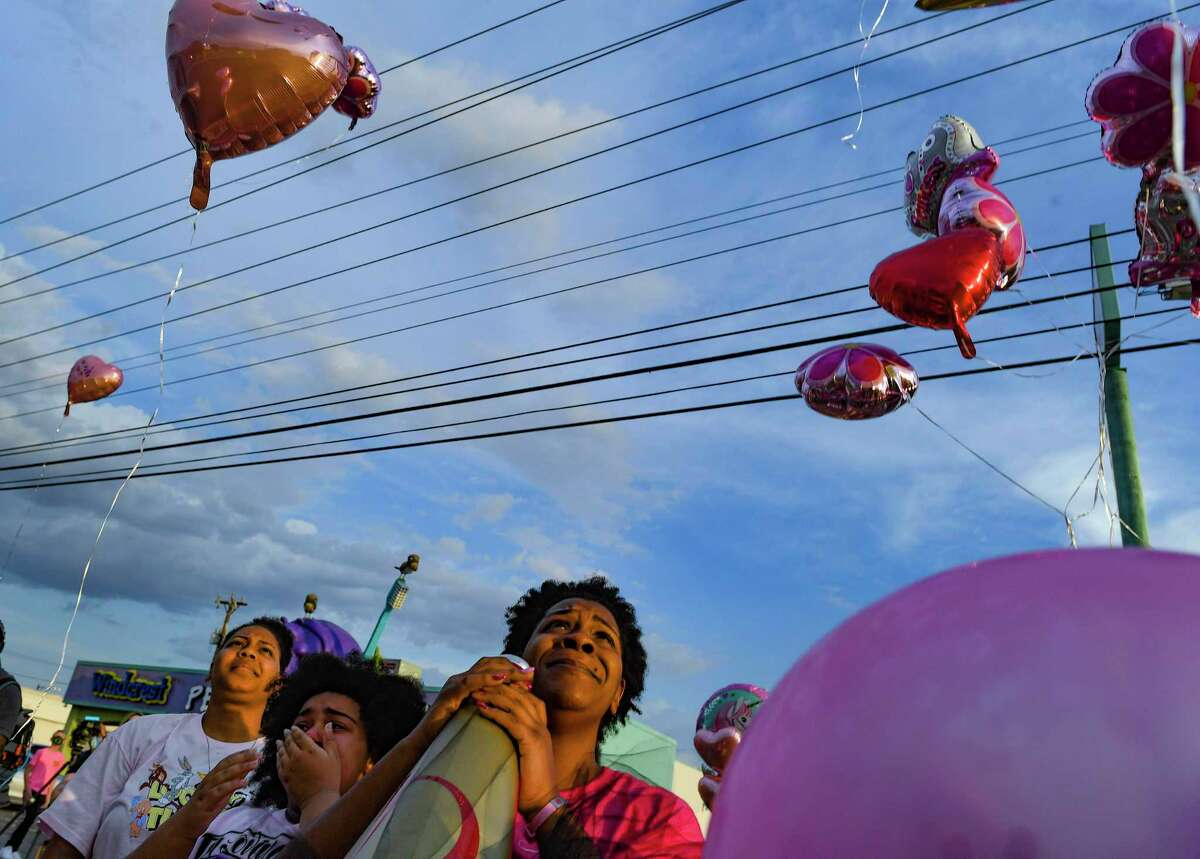Patricia Crawford, whose daughter, 11-year-old Donita Elizabeth Henry-Phillips, was shot and killed on Saturday, watches as balloons are released during a vigil on Friday, Aug. 21, 2020. A second victim is hospitalized. No arrests have been made.