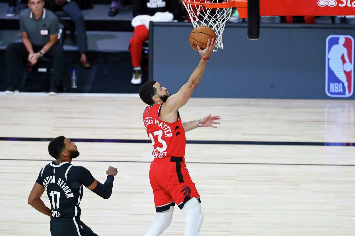 Toronto Raptors guard Fred VanVleet (23) shoots a layup in front of Brooklyn Nets guard Garrett Temple (17) during the first half of Game 3 of an NBA basketball first-round playoff series, Friday, Aug. 21, 2020, in Lake Buena Vista, Fla. (Kim Klement/Pool Photo via AP)