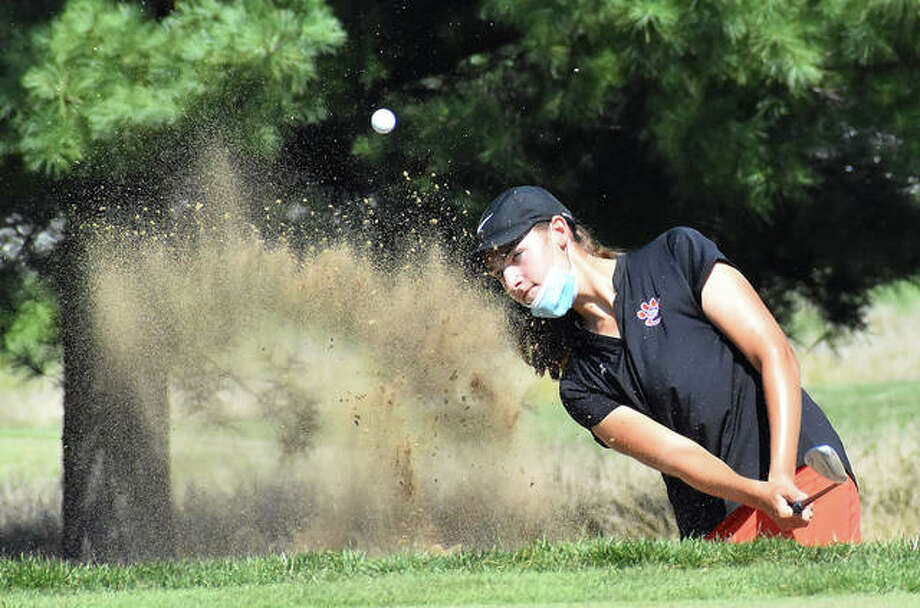Edwardsville's Nicole Johnson hits her shot out of the bunker during the Belleville West Invitational on Friday at Orchards Golf Course in Belleville. Photo: Matt Kamp|The Intelligencer