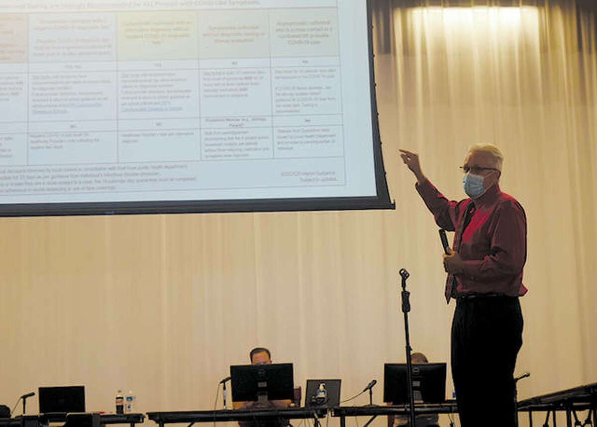 Jacksonville District 117 Superintendent Steve Ptacek gives a presentation on changes to the Illinois Department of Health's guidelines and how how those changes would allow them to return to in-person learning. The district is on course to start in-person learning on Monday