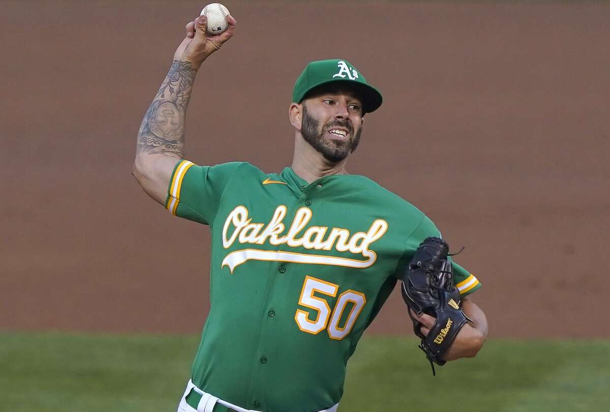 Mike Fiers of the Oakland Athletics pitches against the Los Angeles Angels in the top of the second inning at RingCentral Coliseum on Aug. 21, 2020, in Oakland, Calif.