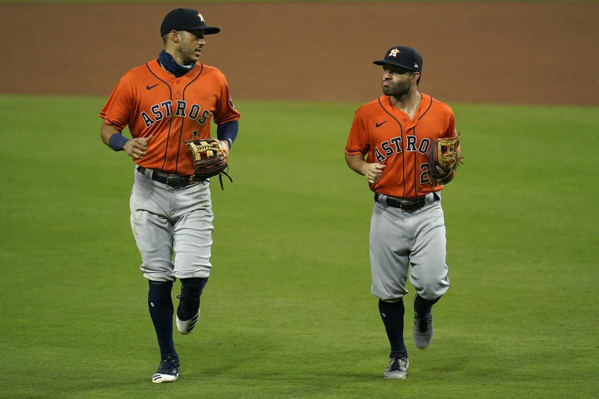 Houston Astros shortstop Carlos Correa, left, speaks with second baseman Jose Altuve at the end of the eighth inning in a baseball game against the San Diego Padres, Friday, Aug. 21, 2020, in San Diego. (AP Photo/Gregory Bull)
