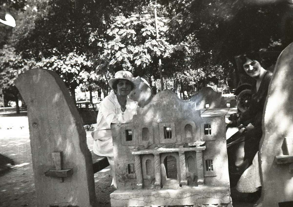 Clelia Mabrito Steiber of San Antonio, left, and an unidentified friend or family member sit at a unique concrete picnic table with an Alamo motif in the 1920s. It's believed the table was in Brackenridge Park but if so it's no longer there. Experts have admired it but no one seems to know where it came from or what happened to it.