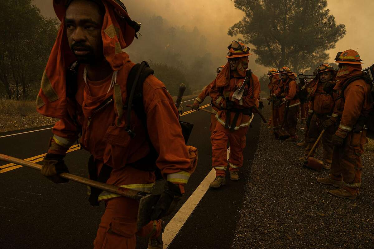 August 20, 2020, Mocassin, California, USA: Fire crews move along Hwy 49 as the MocFire burns near San Francisco's Hetch Hetchy Power and Water on Thursday. (Tracy Barbutes/ZUMA Wire/TNS)