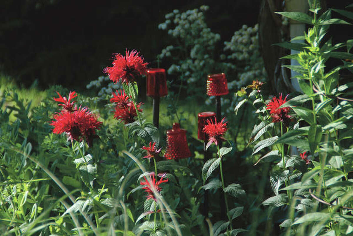 Garden art can fill in late summer voids or create a focal point in the garden.
