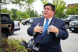 Gov. J.B. Pritzker responds to questions Aug. 10 during a news conference at Morgan Park in Chicago. Pritzker is providing a substantive look at how he wants to make the state a completely renewable-energy state by 2050 with tighter controls on utility companies amid an influence-peddling scheme involving ComEd.