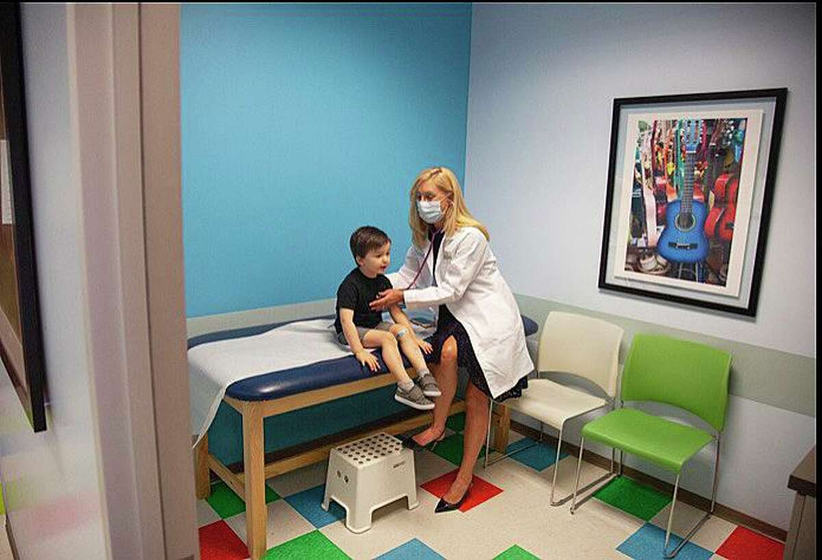Dr. Victoria Regan, pediatrician and VP of Children's and Women's Service line at Memorial Hermann, gives three-year-old James Chambers his routine check-up.