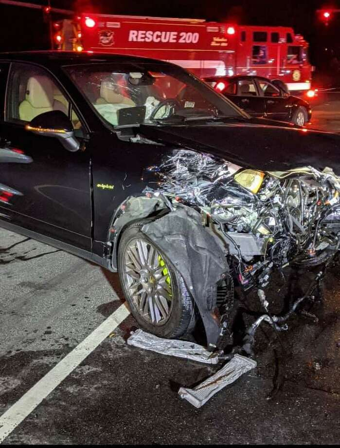 Multiple people were hospitalized after a crash near Main Street in Trumbull Friday night. Photo: Long Hill Volunteer Fire Company /
