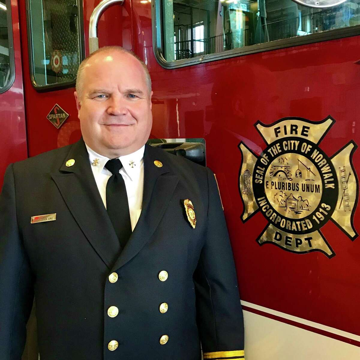 Former Norwalk Assistant Fire Chief Chris King retired in July after he and his son were the focus of an investigation into apparent cheating on the department's entrance exam.