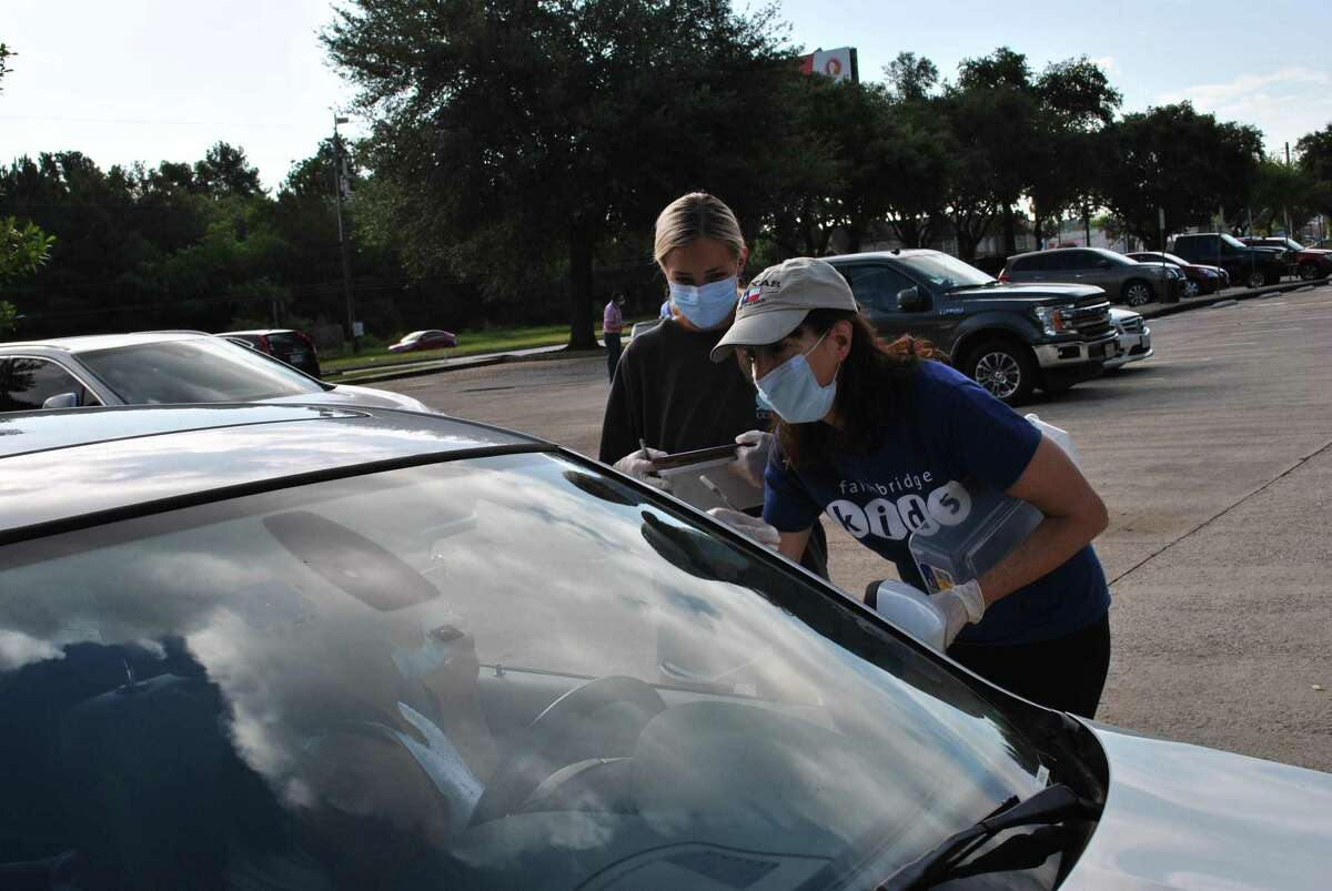 Mobile Food Fair at Northwest Assistance Ministries on July 18, 2020. Volunteers directed traffic, sorted groceries, made grocery bags, and loaded food into vehicles.