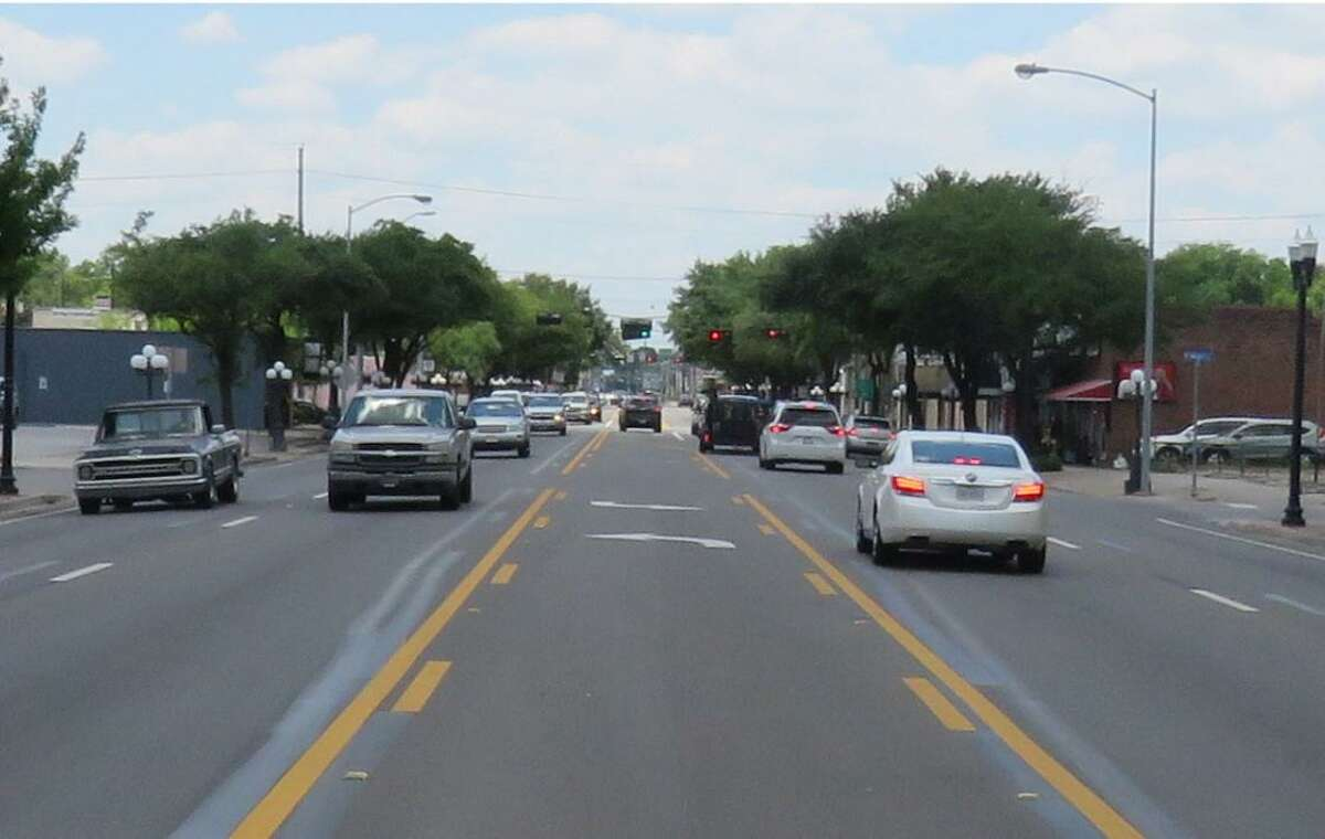 One of the five main goals of the TEDC's drafted 3-year plan includes development of Old Town Tomball. Shown here, cars drive on Main Street in Old Town Tomball.