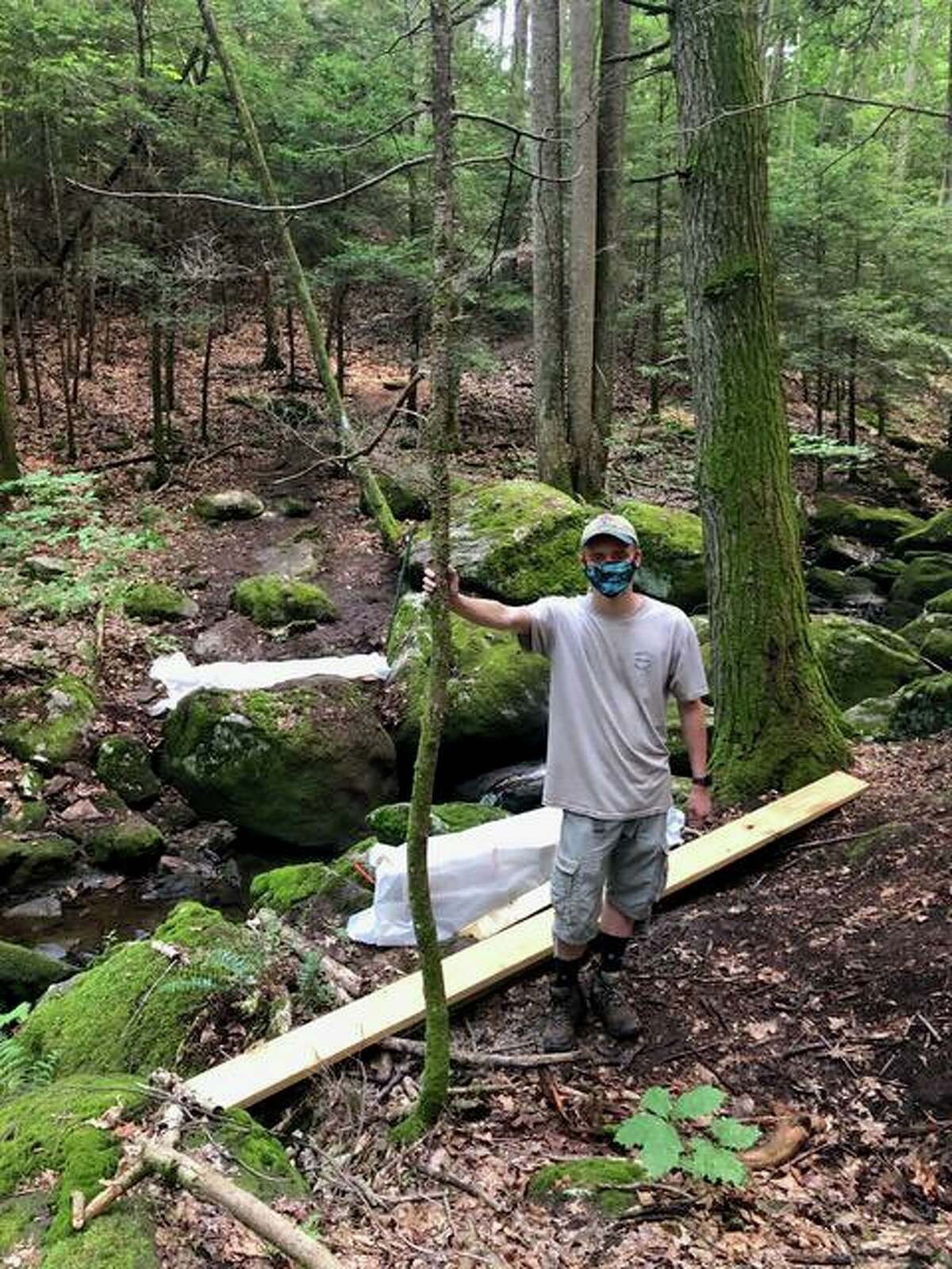 Korey Barber, a Boy Scout with the Housatonic Troop 27 Life Scout and a rising senior at Shelton High School, is organizing construction of a bridge crossing Round Hill Brook on the Paugussett trail.