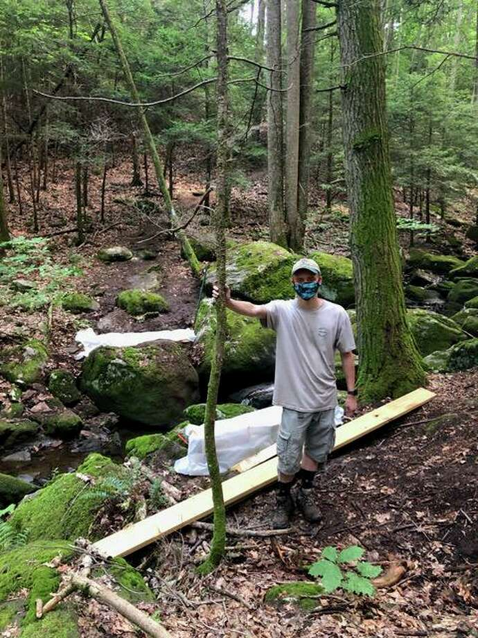 Korey Barber, a Boy Scout with the Housatonic Troop 27 Life Scout and a rising senior at Shelton High School, is organizing construction of a bridge crossing Round Hill Brook on the Paugussett trail. Photo: Contributed Photo / / Connecticut Post