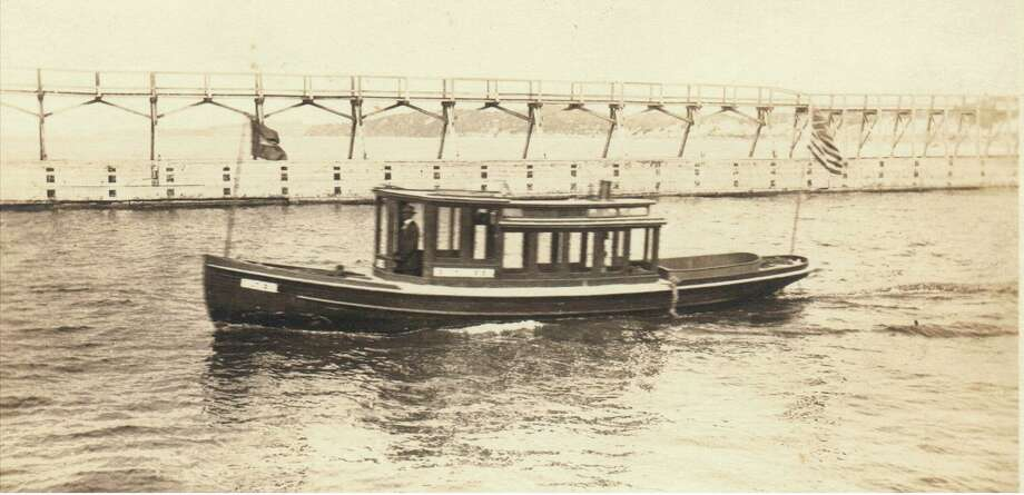 A government inspection tugboat passes by the Manistee pier circa 1905. (Manistee County Historical Museum photo)