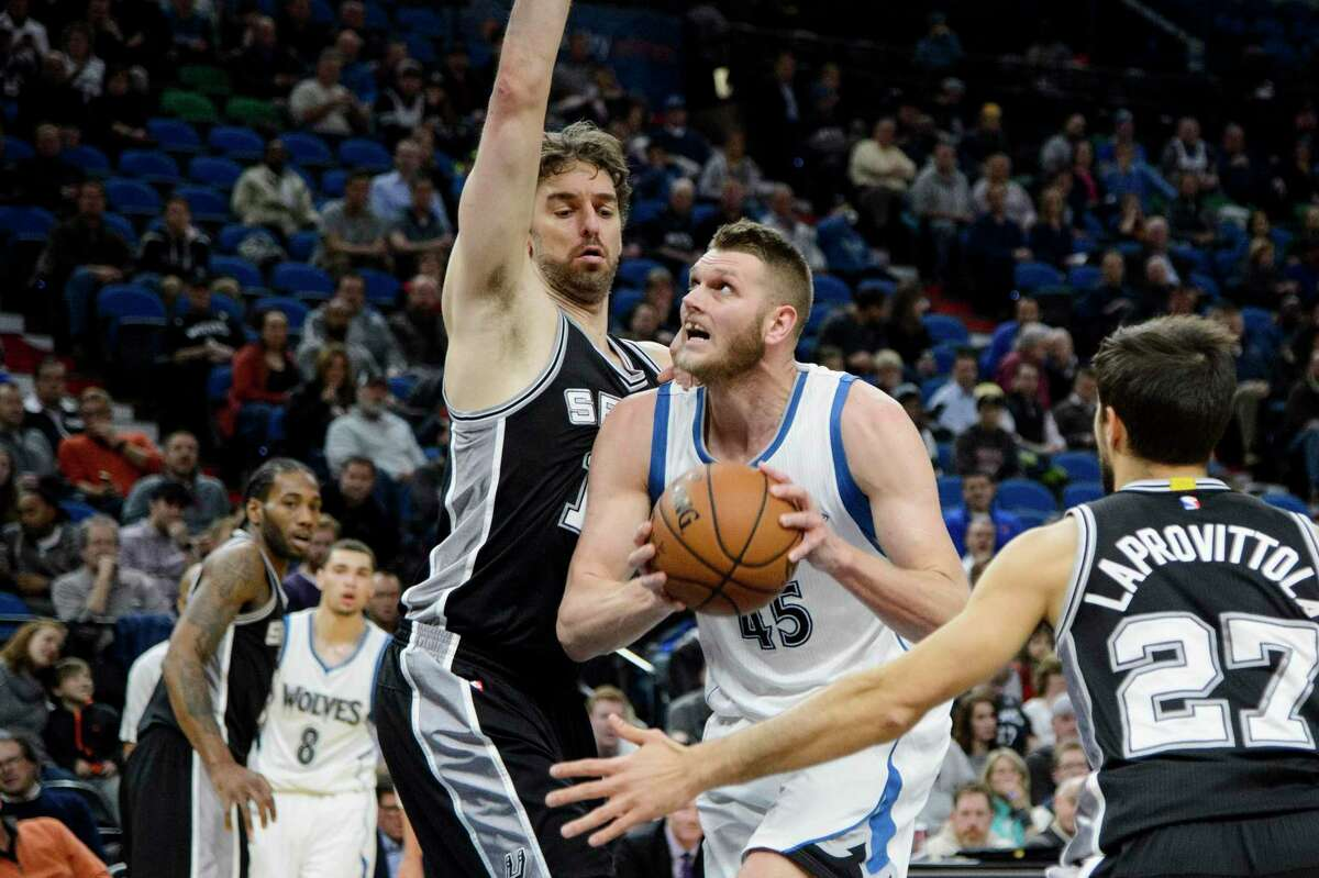 MINNEAPOLIS, MN - DECEMBER 06: Cole Aldrich #45 of the Minnesota Timberwolves shoots the ball against Pau Gasol #16 and Nicolas Laprovittola #27 of the San Antonio Spurs during the game on December 6, 2016 at Target Center in Minneapolis, Minnesota. NOTE TO USER: User expressly acknowledges and agrees that, by downloading and or using this Photograph, user is consenting to the terms and conditions of the Getty Images License Agreement. (Photo by Hannah Foslien/Getty Images)