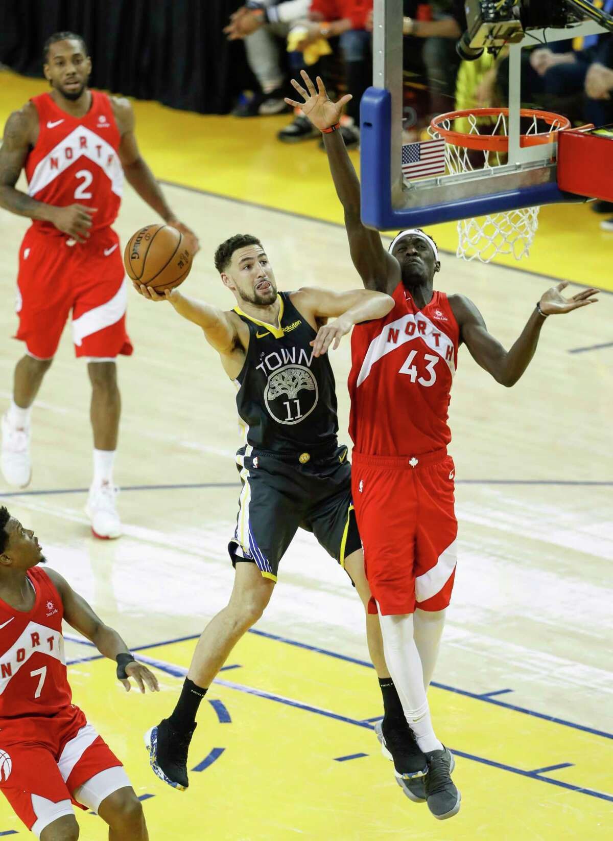 Golden State Warriors' Klay Thompson shoots against Toronto Raptors' Pascal Siakam in the third quarter during game 6 of the NBA Finals between the Golden State Warriors and the Toronto Raptors at Oracle Arena on Thursday, June 13, 2019 in Oakland, Calif.