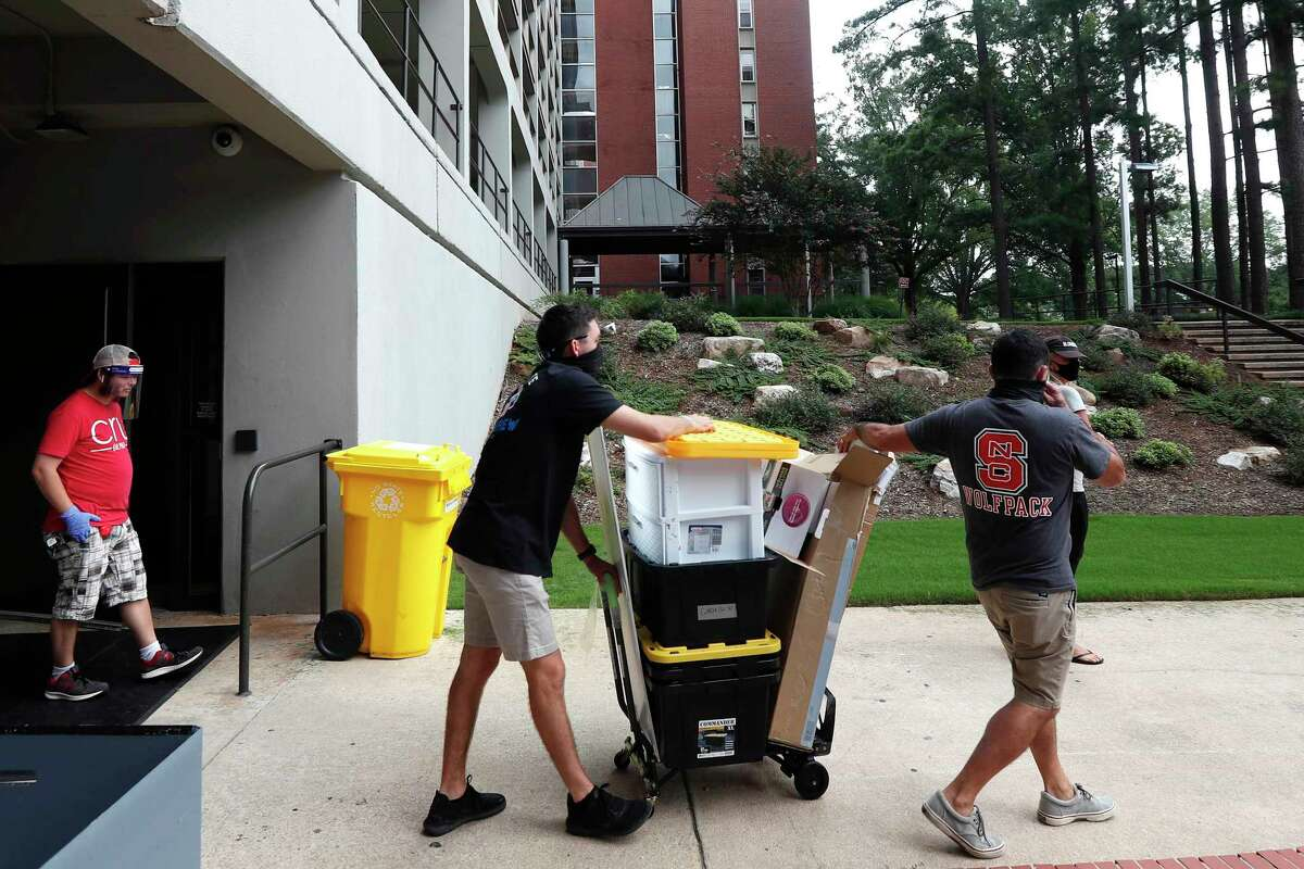 FILE - In this July 31, 2020, file photo, college students begin moving in for the fall semester at N.C. State University in Raleigh, N.C. Colleges are eager to share their reopening plans as they encourage students to return to campus. But fewer of them are talking about the elephant in the room: what happens if they need to shut down again.(AP Photo/Gerry Broome, File)