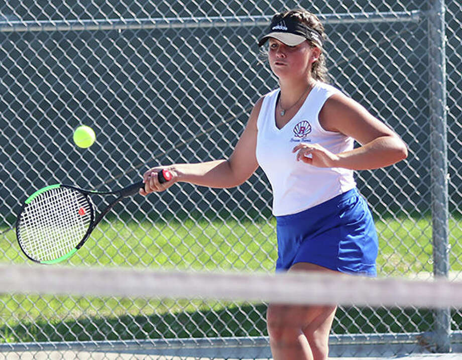 Roxana senior Stephanie Kamp hits a forehand during her No. 1 singles match against Alton on Saturday morning at the fourth annual Andy Simpson Invitational girls tennis tournament at Alton High in Godfrey. Photo: Greg Shashack | The Telegraph