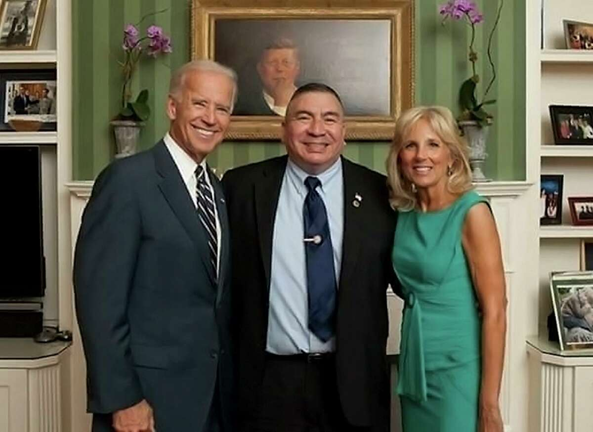 Larry Romo, a candidate for the Bexar County district clerk's office, poses with Joe and Jill Biden during his tenure as the director of Selective Service.