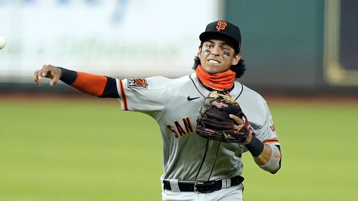 San Francisco Giants' Mauricio Dubon throws to first during the first inning of a baseball game against the Houston Astros Monday, Aug. 10, 2020, in Houston. (AP Photo/David J. Phillip)