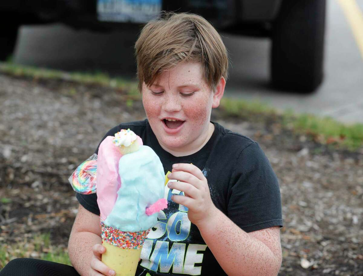 Paul Flowers reacts as he digs into a shake from Shake You Up Milkshake Bar as part of a fundraiser for The Woodlands Children's Museum on Saturday in The Woodlands. The museum reopens to the public Wednesday.