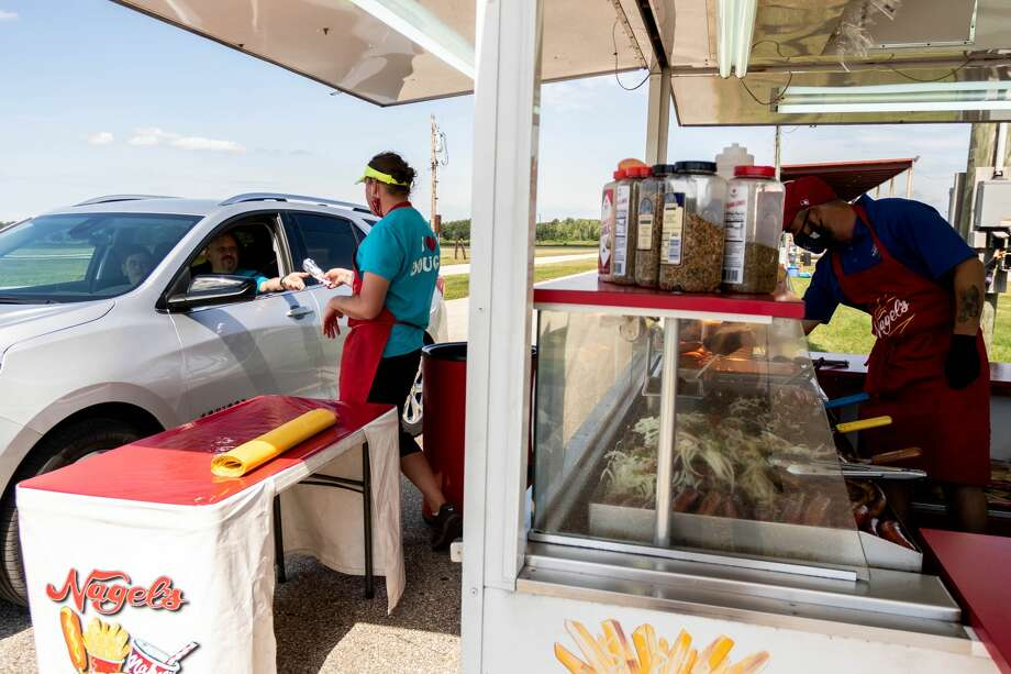 People order fair food from their vehicles during a drive through event Saturday, Aug. 22, 2020 at the Midland County Fairgrounds. (Cody Scanlan/for the Daily News) Photo: (Cody Scanlan/for The Daily News)