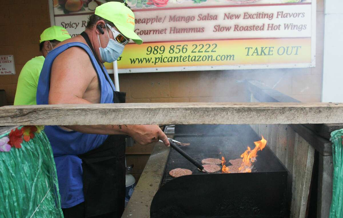 Hundreds of burger fans made their way to Caseville on Saturday as the Slice of Cheeseburger event wound down. 'A Slice of Cheeseburger,' a loose-knit celebration of the town's annual festival organized by downtown business owners after the 2020 Cheeseburger in Caseville Festival was canceled by organizers in early June, wrapped up this weekend.
