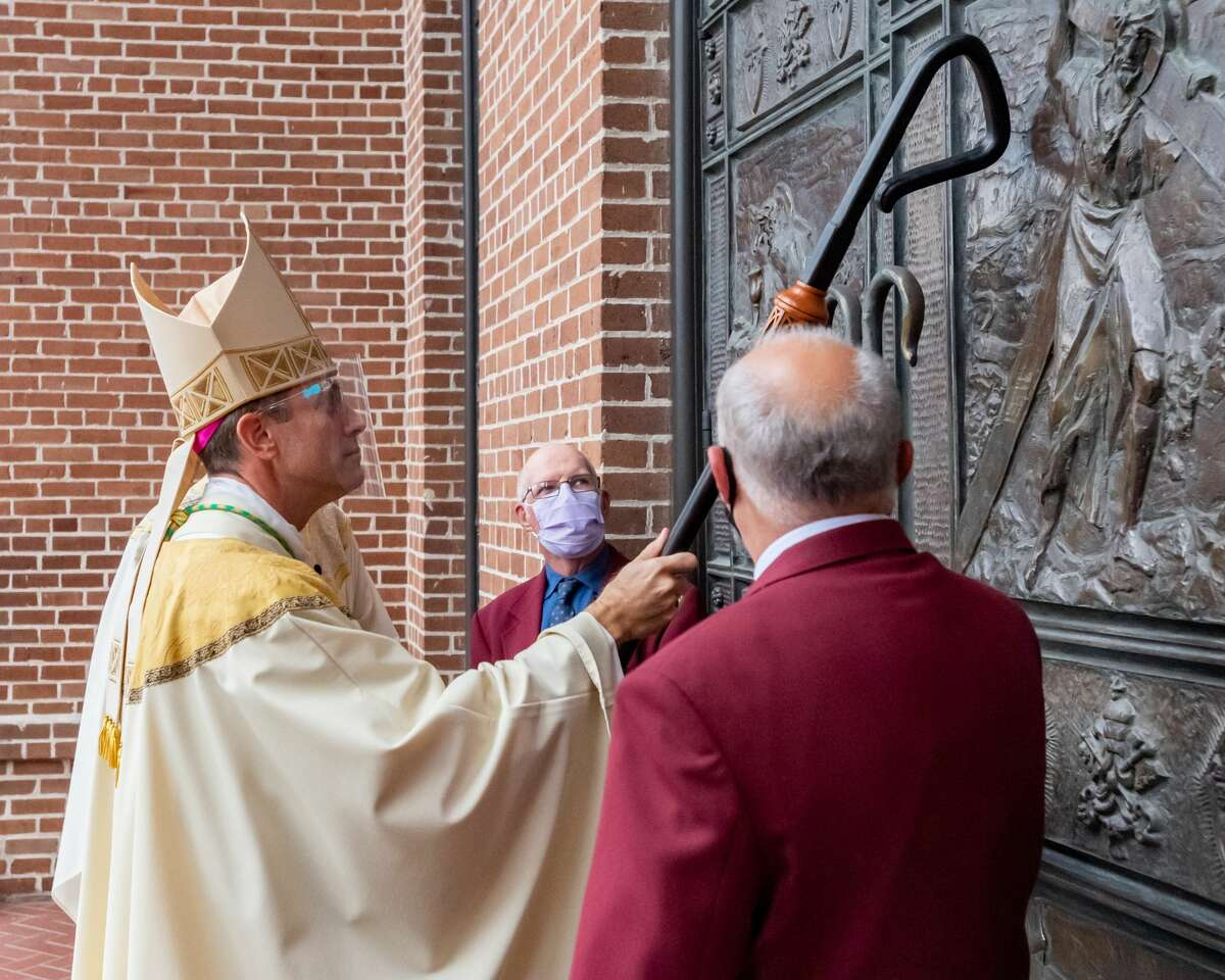 The Bishop knocks on the door with his crook to be let into his new church. Newly ordained Bishop David Toups said his first Mass in his new home church, St. Anthony Cathedral Basilica since being ordained. Photo made on August 22, 2020. Fran Ruchalski/The Enterprise