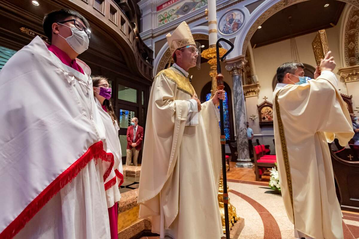 Bishop Toups waits to walk up the aisle of his new church. Newly ordained Bishop David Toups said his first Mass in his new home church, St. Anthony Cathedral Basilica since being ordained. Photo made on August 22, 2020. Fran Ruchalski/The Enterprise