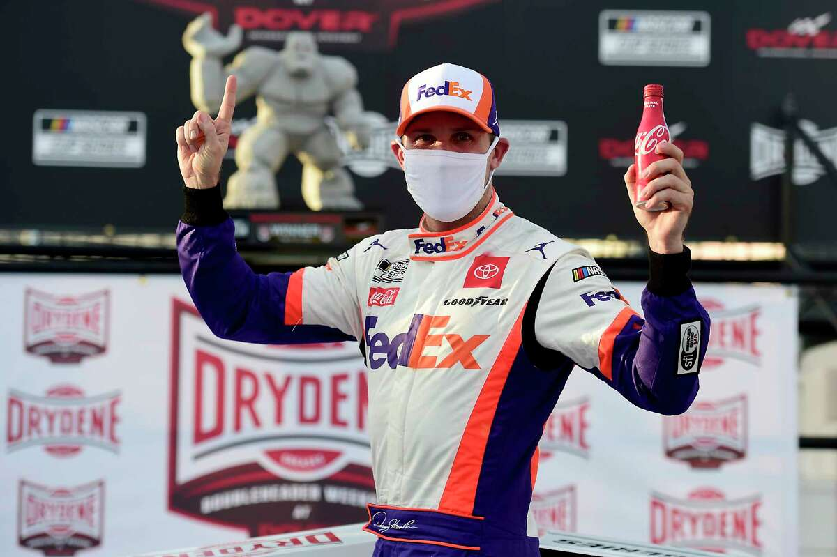 DOVER, DELAWARE - AUGUST 22: Denny Hamlin, driver of the #11 FedEx Office Toyota, celebrates in Victory Lane after winning the NASCAR Cup Series Drydene 311 at Dover International Speedway on August 22, 2020 in Dover, Delaware. (Photo by Jared C. Tilton/Getty Images)